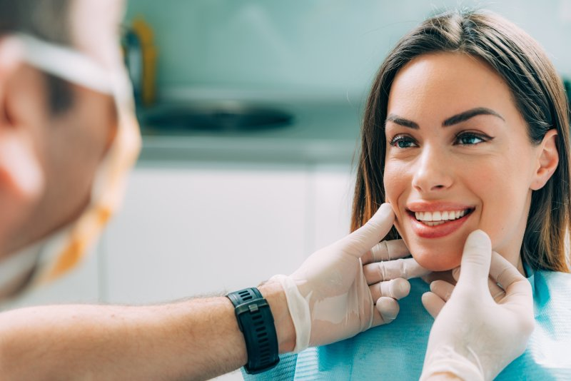 Woman smiling at cosmetic dentist